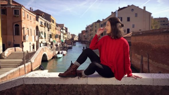 Thumbnail for Woman Sitting on the Bridge in Venice