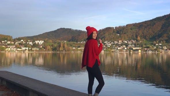 Thumbnail for Woman Raising Her Hands at Mountain Lake