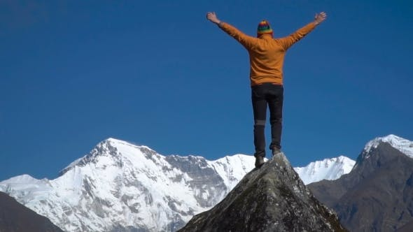 Thumbnail for Man Reaching Up Top of Mountain and Raised Hands