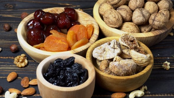 Thumbnail for Dried Figs, Apricots, Plums and Nuts on Wooden Background