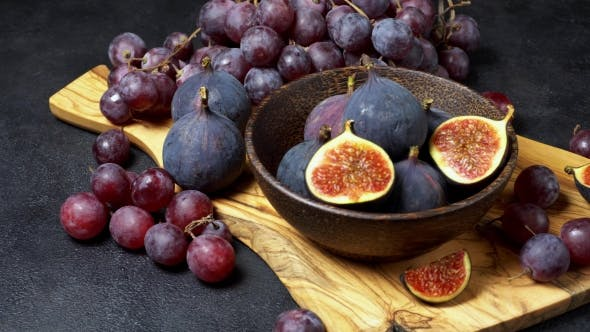Cover Image for Ripe Grapes and Figs on Dark Concrete Background