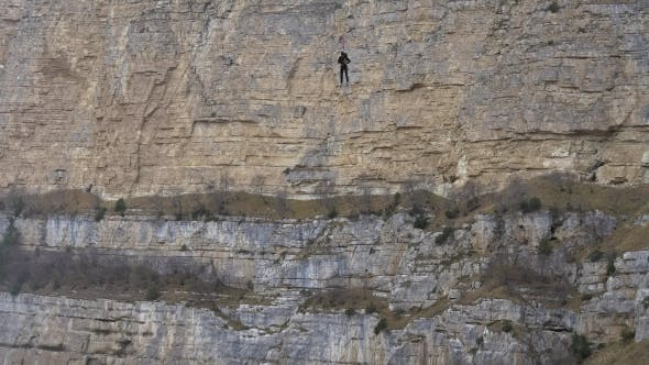 Thumbnail for Woman in the Mountains Hanging on a Rope