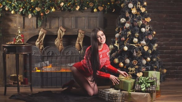 Thumbnail for Seductive Girl in Red Lingerie and Red Sweater Decorated Tree.