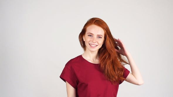 Thumbnail for Pretty Cheerful Redhead Girl Laughs on the Camera on White Background