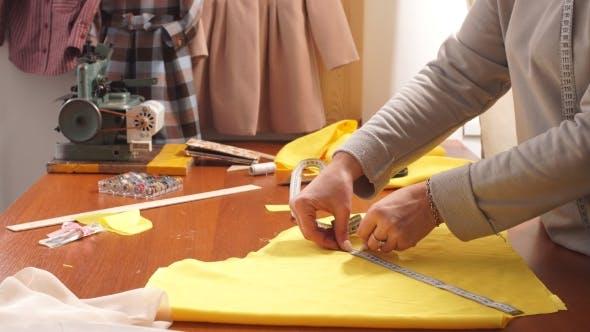 Thumbnail for Elderly Woman Fashion Designer Works in Studio. Using Measuring Tape.