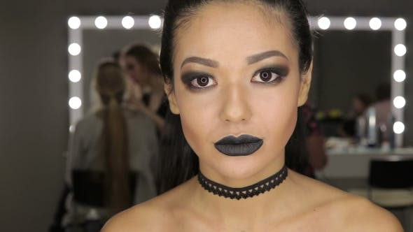 Thumbnail for High Fashion Beauty Model Girl with Black Make Up and Long Lushes. Black Lips.