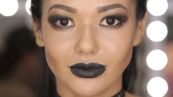 Cover Image for High Fashion Beauty Model Girl with Black Make Up and Long Lushes. Black Lips.