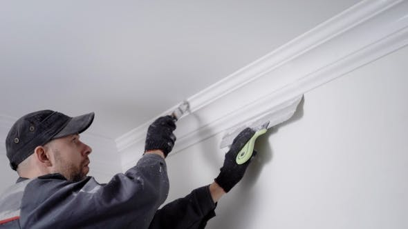 Thumbnail for Experienced Painter Is Coloring Plinth, Fixing Between Ceiling and Walls in a White
