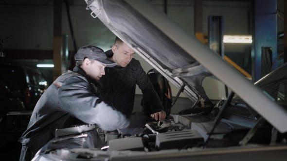 Thumbnail for Car Mechanic and Customer Checking Car Engine