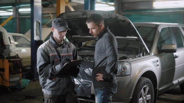 Thumbnail for Car Mechanic and Customer Near Car