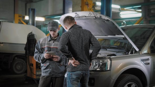 Thumbnail for Client and Car Mechanic Standing Near Car