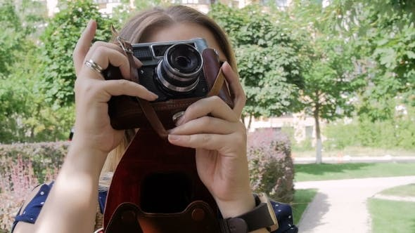 Thumbnail for Footage of Young Woman Making Photo on Old Manual Camera at Park