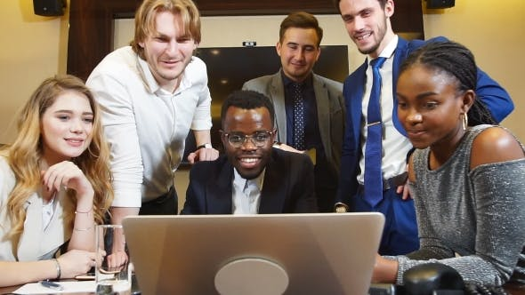 Thumbnail for Group Of Multi-Ethnic Startup Entrepreneur Smiling and Looking at Camera.