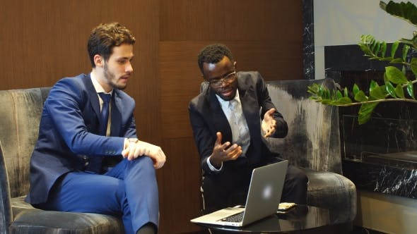 Thumbnail for Two Young Businesspeople Having Discussion.