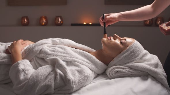 Thumbnail for Cosmetician Applying Facial Mask To the Face of Young Woman in Spa Salon.