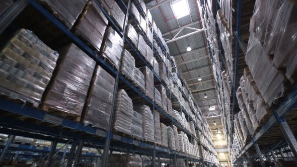 Thumbnail for Shelves of Cardboard Boxes Inside a Storage Warehouse