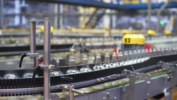 Spill in Glass Bottles at the Plant Conveyor