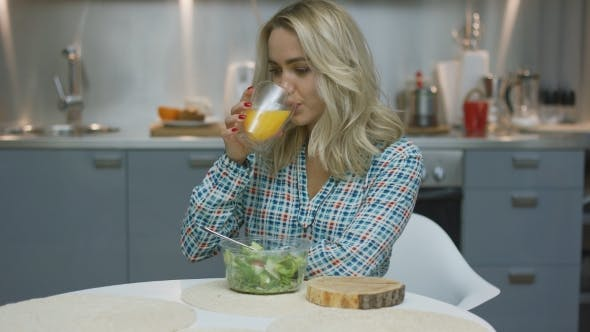 Thumbnail for Woman Drinking Juice and Eating Salad