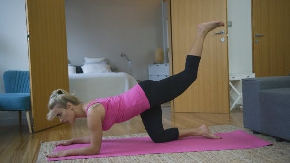 Thumbnail for Woman Performing Leg Exercise