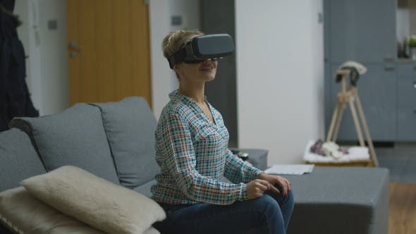 Amazed Woman in VR Headset