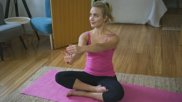 Cover Image for Beautiful Woman Stretching Fingers During Training