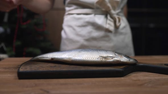 Thumbnail for Chef Puts Herring Fish To the Wooden Board and Prepares for Cooking, Making of Fish Meals, Dishes