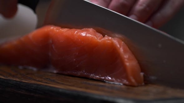 Thumbnail for The Cook Cuts Salmon Fillet, Chef Slices Fish for Cooking, Dishes with Fish, Diet and Healthy Food