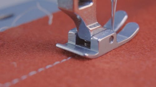 Sewing Needle of the Machine Sews Fabric