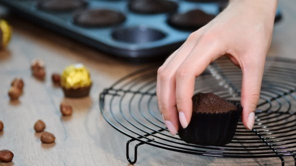 Thumbnail for Chocolate Muffin Putting Freshly Baked Chocolate Muffins on the Grill