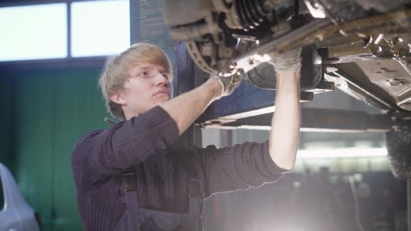 Thumbnail for Young Technician Man Making Engine Service of Car in Garage