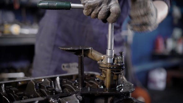 Thumbnail for Unrecognizable Technician Using Wrench While Repairing Engine in Workshop
