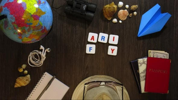 Thumbnail for Phrase Family Trip on a Dark Wooden Background with Travel Accessories