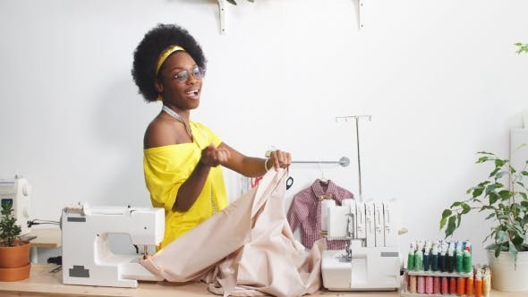 Thumbnail for Happy Black Woman Working As Dressmaker in Atelier.