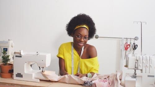 Attractive Fashion Designer Working at Home Studio