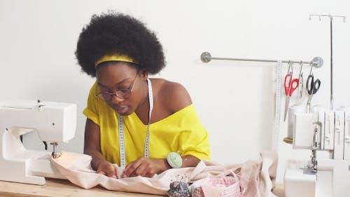Attractive Fashion Designer Working.