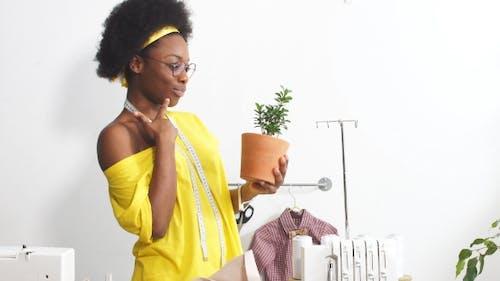 Attractive Fashion Designer Working