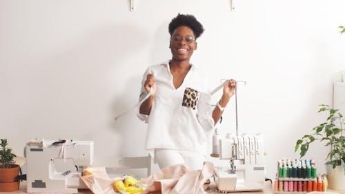 Happy Black Woman Working in Atelier