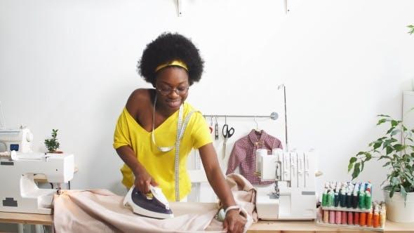 Happy Fashion Designer Uses Iron