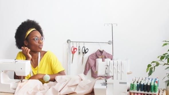 Portrait of Dressmaker in Atelier