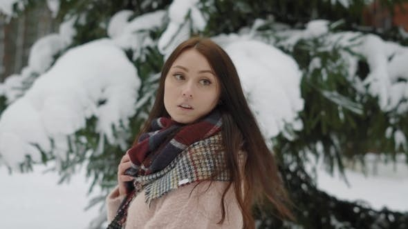 Thumbnail for Portrait of a Woman Who Walks with Her Hair in the Winter Forest