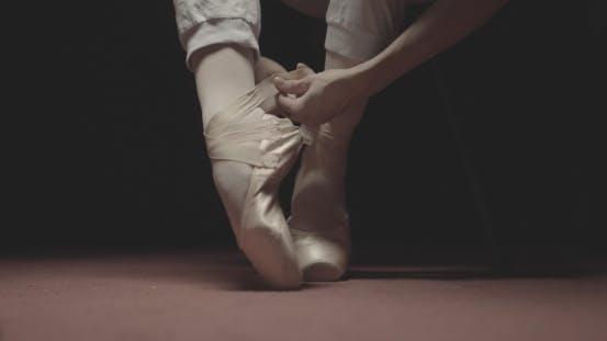 Thumbnail for Ballet Dancer Putting on Her Ballet Shoes