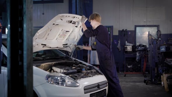Thumbnail for Car Owner Woman Is Accepting Her White Car After Repair in a Car Repair Shop