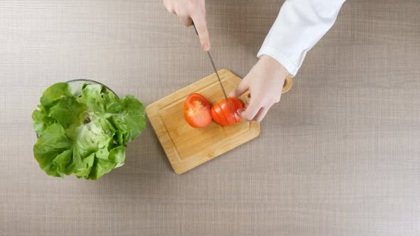 Thumbnail for Chef Hands Cutting Tomatoes on Wooden Board