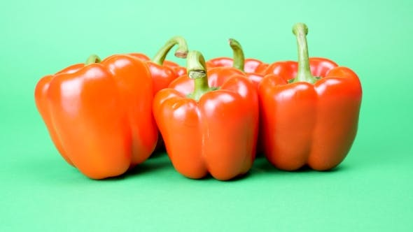 Thumbnail for Five Red Sweet Peppers on Green Background