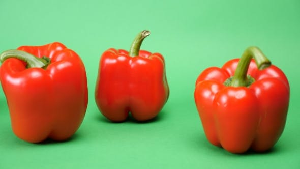 Thumbnail for Tracking on Five Sweet Red Peppers on Green Background