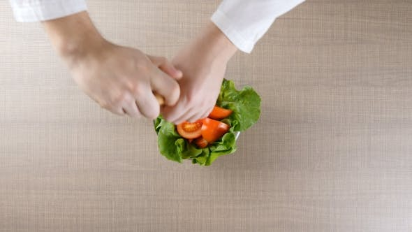 Thumbnail for Chef Hands Salting the Salad