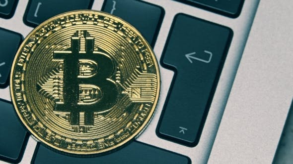 Thumbnail for Shiny Bitcoin on the Computer Keyboard Getting Dark