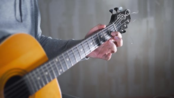 Thumbnail for Guitarist Plays on the Acoustic Western Guitar with Steel Strings Spanish Random Chords