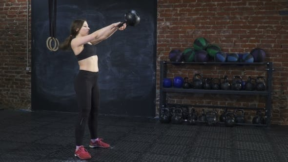 Thumbnail for Fitness Woman Doing Kettlebell Swings in Gym