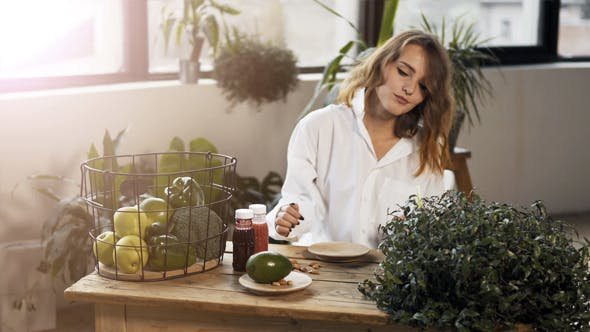 Thumbnail for Girl At Table with Healthy Food
